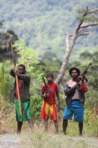 Armed clansmen in New Guinea