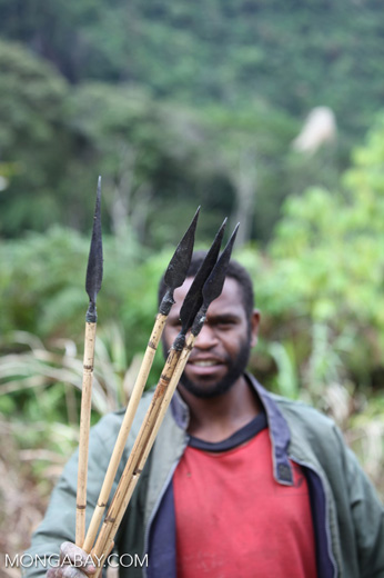 Armed Papuan men