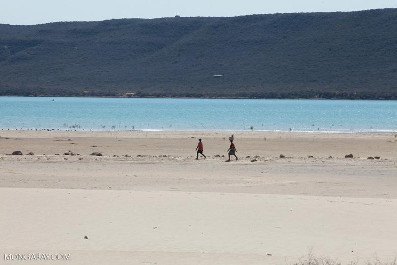 Vezo walking on a beach / sand spit