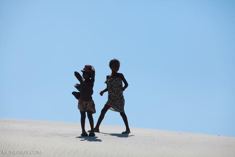 Vezo kids dancing atop a sand dune [madagascar_8031]