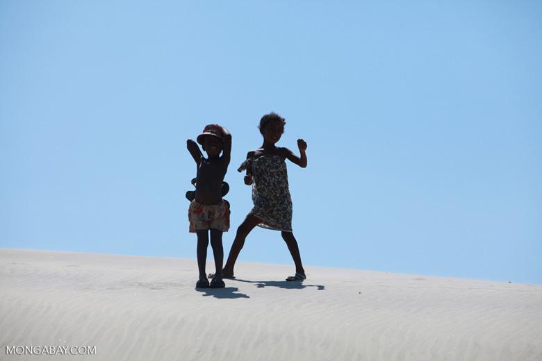 Vezo kids dancing atop a sand dune [madagascar_8037]