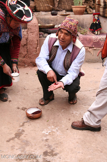 Making natural red dye in a Chinchero market
