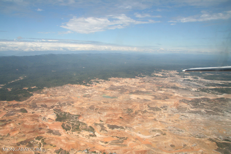 Aerial view of open pit mine in the Amazon rainforest