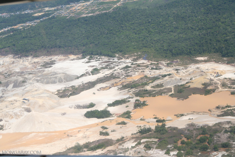 Open pits at  the Rio Huaypetue mine.
