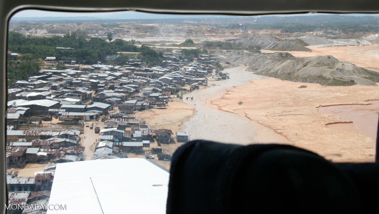 Miners' shantytown next to Rio Huaypetue gold mine