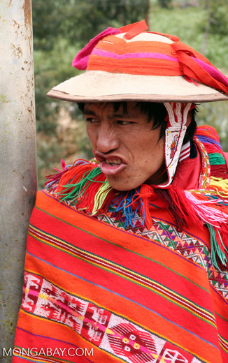 Willoq man in Ollantaytambo wearing traditional red clothing