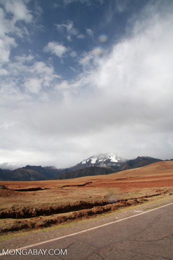 Cuzco countryside with view of snow-capped peaks in Peru