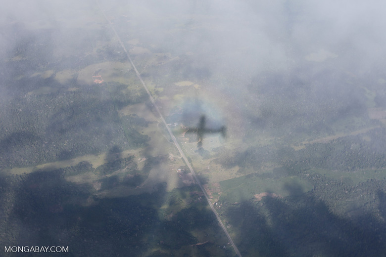 Shadow of an airplane in the clouds over the Amazon in southwestern Peru