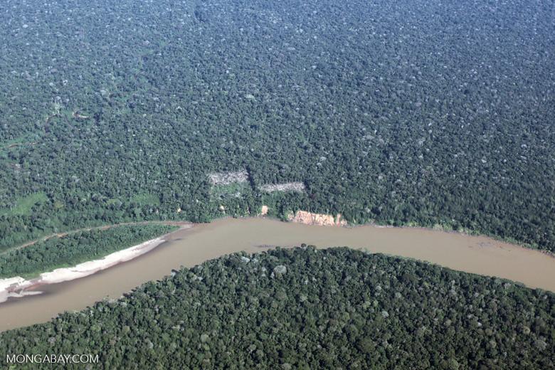 Deforestation along a river in Peru's southeastern Amazon region