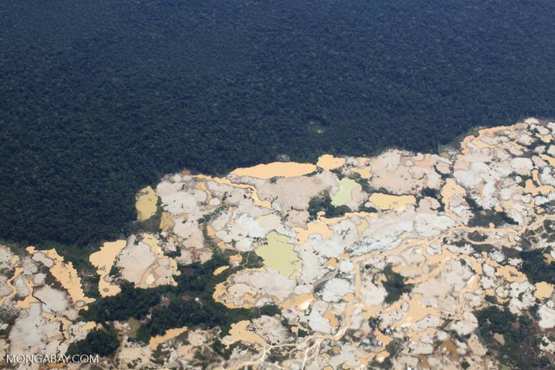 Aerial view of Amazon rainforest landscape scarred by open pit gold mining