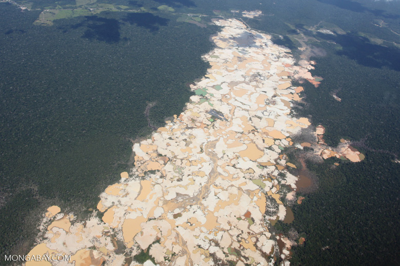 Overview view of Amazon rainforest landscape scarred by open pit gold mining