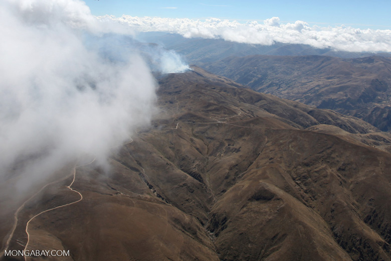 Agricultural fire in the high Andes [peru_aerial_1750]
