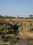 Sport Utility Vehicle crossing a river in Africa