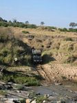 Vehicle crossing a river in Africa