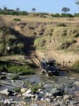 SUV crossing a river in Africa