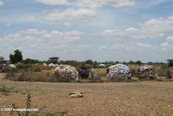 Turkana grass huts augmented with aid bags from Kakuma refugee camp