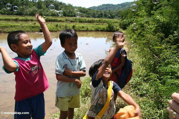 Toraja kids playing with bubbles at Londa Nanggala (Toraja Land (Torajaland), Sulawesi)