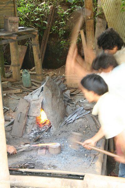 Metal workers pounding a machete into shape (Toraja Land (Torajaland), Sulawesi)