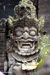 Statue at Puri Saren Agung palace; with offering (Ubud, Bali)