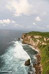 Breaking waves below cliffs of Uluwatu (Jimbaran, Bali