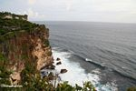 Incoming waves below cliffs at Uluwatu (Jimbaran, Bali