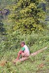 Local man resting after a day in the forest (Java)