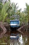 Boat docked between Nipa palms on the Seikonyer River (Kalimantan, Borneo - Indonesian Borneo)