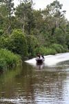 Speedboat carrying silica and gold miners on the Seikonyer River (Kalimantan, Borneo - Indonesian Borneo)