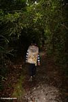 Staff member at Pondok Tanggui leading walk to orangutan feeding platform (Kalimantan, Borneo - Indonesian Borneo)