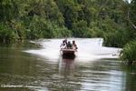 Silica miners in a speedboat heading upriver to an illegal mining zone (Kalimantan, Borneo - Indonesian Borneo)
