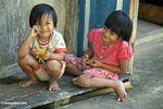 Little girls on a porch in Lemo (Toraja Land (Torajaland), Sulawesi)