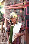 Toraja boy drinking 'tuak' (Toraja Land (Torajaland), Sulawesi)
