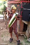 Toraja boy with bamboo tube full of palm wine (Toraja Land (Torajaland), Sulawesi)