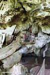 Londa Nanggala cave with hanging coffins and funeral effigies (Toraja Land (Torajaland), Sulawesi)