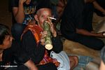 Old man drinking rice wine at funeral (Toraja Land (Torajaland), Sulawesi)