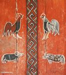 Painting of roosters and water buffalos--orange, red, and dark brown paint (Toraja Land (Torajaland), Sulawesi)