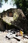 Stone tomb carved in giant granite rock at Pana (Toraja Land (Torajaland), Sulawesi)