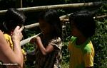 Pana girls playing with bubbles (Toraja Land (Torajaland), Sulawesi)