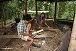 Men making bamboo sheaths for hand knives (Toraja Land (Torajaland), Sulawesi)