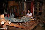 Woman weaving silk in Rantepao (Toraja Land (Torajaland), Sulawesi)