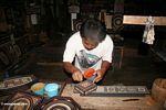 Painting carved wooded boxes at Keta Kese (Toraja Land (Torajaland), Sulawesi)