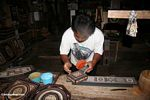 Toraja man painting carved wooded boxes at Keta Kese (Toraja Land (Torajaland), Sulawesi)
