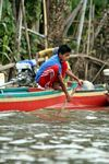 Boy streering a traditional boat near Lake Tempe (Sulawesi - Celebes)
