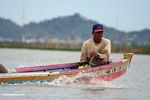 Man in traditional Buginese motorized boat on Lake Tempe (Sulawesi - Celebes) -- sulawesi7654