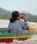 Woman with baby in traditional Buginese motorized boat (Sulawesi - Celebes)