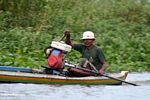 Man driving traditional Buginese motorized canoe (Sulawesi - Celebes) -- sulawesi7671