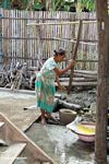 Woman working with yellow dye used with silk (Sulawesi - Celebes)