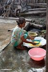 Woman working with material used as yellow dye for silk (Sulawesi - Celebes)